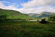 A Ruined Scottish Castle, Overlooked By Mountains. Royalty Free Stock Photography