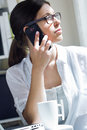 Free Woman Talking On Mobile Phone At Work Royalty Free Stock Images - 32337029
