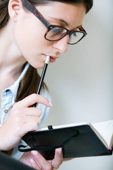 Free Woman Taking Notes At Home Royalty Free Stock Photography - 32336277