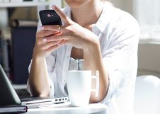 Free Woman Talking On Mobile Phone At Work Stock Photos - 32336953