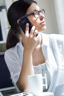 Woman Talking On Mobile Phone At Work Royalty Free Stock Images