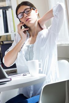 Free Woman Talking On Mobile Phone At Work Royalty Free Stock Photos - 32337098
