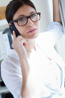 Free Woman Talking On Mobile Phone At Work Royalty Free Stock Photos - 32337218