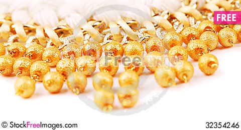 Free Necklace Of Gold Pearls On A White Bacground Royalty Free Stock Image - 32354246