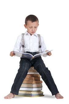 Free Boy Sitting On A Pile Of Books Stock Photos - 32355863