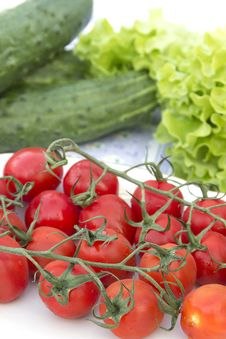 Cherry Tomatoes Cucumber Salad On The Tablecloth Stock Photo