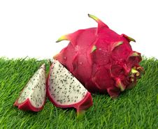 Free Vivid Dragon Fruit On A Grass Stock Photo - 32379740