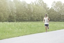 Free Athlete Runs On The Road Royalty Free Stock Photo - 32381925