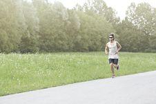 Athlete Runs On The Road Royalty Free Stock Photo