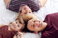 Free Happy Father, Little Daughter And Mother Lie On Bed Royalty Free Stock Photos - 32395718