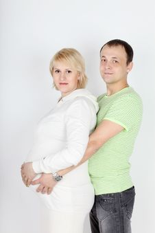 Free Happy Pregnant Wife In White And Husband Hold Belly Stock Image - 32395981