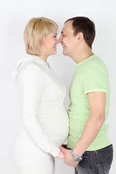 Happy Pregnant Wife And Husband Touch Each Other Noses Royalty Free Stock Photos