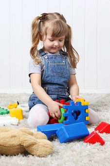 Free Happy Little Girl Play Colorful Toys Stock Photography - 32396152