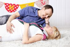 Free Happy Pregnant Wife And Husband Lie On Carpet Royalty Free Stock Photos - 32396318