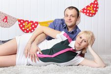Free Happy Pregnant Wife And Husband Lie On Carpet Royalty Free Stock Photo - 32396375