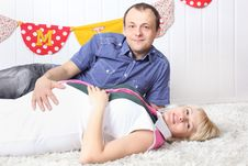 Free Happy Pregnant Wife And Husband Lie On Carpet Stock Photos - 32396403