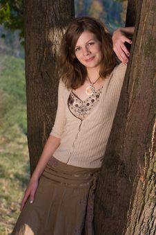 Free Smiling Girl Near Tree Royalty Free Stock Image - 3242236