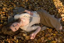 Free Girl On Autumn Leaves Royalty Free Stock Photography - 3246547