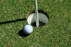 Free Golf Ball On Green Near Hole Stock Image - 3246561