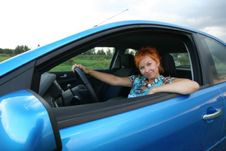 Free Young Woman Is Siting In A Car Stock Image - 3247241