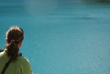 Free Girl Overlooking A Blue Lake Stock Photos - 3248673