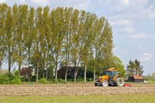 Free Farmer On A Tractor Royalty Free Stock Images - 32410169