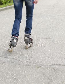 Free Girl Rides On Roller Skates On Asphalt. Legs In Rollers Royalty Free Stock Photos - 32419798