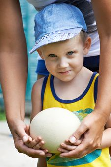 Free Little Boy Holding An Ostrich Eggj Royalty Free Stock Photo - 32454635
