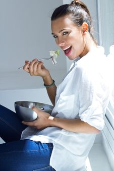 Free Woman Eating Salad At Home Royalty Free Stock Images - 32469059