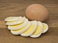 Brown Egg And Egg Slices Royalty Free Stock Images