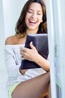 Woman With Tablet At Home Stock Images