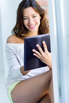 Woman With Tablet At Home Royalty Free Stock Photo