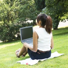 Free Woman Working With Computer Sitting In The Park. Stock Photography - 32479702