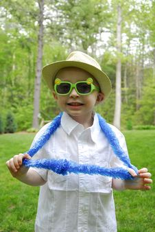 Free Boy With Plastic Glasses And Lei Stock Photo - 32489290