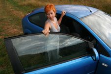 Woman In Dress With Blue Car Stock Photo