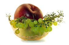 Bowl With Grapes Peach 1 Stock Photos