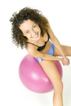 Happy Girl On Pink Ball Royalty Free Stock Photos