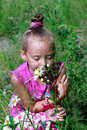 Free Happy Little Girl In Grass Smelling Daisies Royalty Free Stock Photography - 32500897