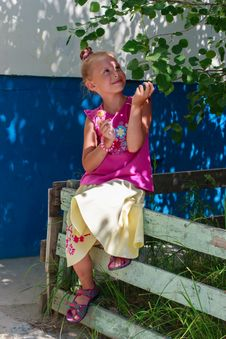 Сute Little Girl Holding A Candy