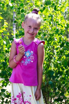 Сute Little Girl Holding A Candy Royalty Free Stock Photography