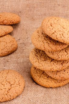 Free Stacked Brown Cookies On Rustic Background Stock Photography - 32507342