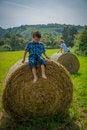 Free Boys On Round Hay Bales Royalty Free Stock Photos - 32549858