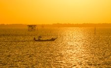 Free Fisherman Boat With Golden Sunrise On The Sea Stock Photos - 32546183