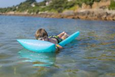 Free Boy  On Inflatable Mattrass Stock Photography - 32549782