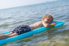 Free Boy  On Inflatable Mattrass Royalty Free Stock Image - 32549796