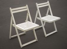 Free Two White Folding Chairs Royalty Free Stock Photos - 32557388