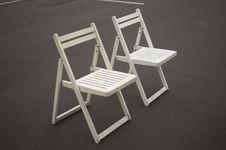Free Two White Folding Chairs Stock Photos - 32563083