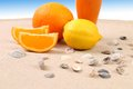 Free Juice Orange Lime Shells On Sand. Stock Photos - 32571713