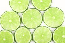 Free Lime Slices Neatly Arranged On A White Background Royalty Free Stock Image - 32593626