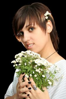 The Young Girl With Flowers Stock Photography